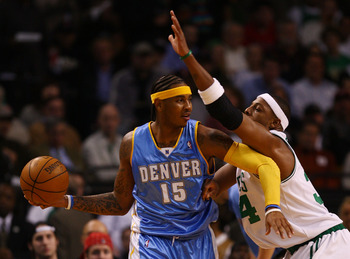 BOSTON - NOVEMBER 07:  Carmelo Anthony #15 of the Denver Nuggets looks to pass as Paul Pierce #34 of the Boston Celtics defends on November 7, 2007 at the TD Banknorth Garden in Boston, Massachusetts.  NOTE TO USER: User expressly acknowledges and agrees