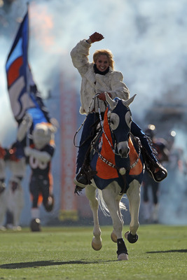 DENVER - JANUARY 02:  Ann Judge-Wegener rides Thunder onto the field as the Denver Broncos prepare to face the San Diego Chargers at INVESCO Field at Mile High on January 2, 2011 in Denver, Colorado. The Chargers defeated the Broncos 33-28.  (Photo by Dou