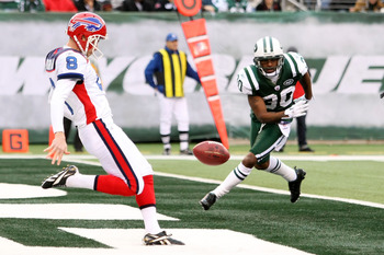 EAST RUTHERFORD, NJ - JANUARY 02:  Brian Moorman #8 of the Buffalo Bills punts against the defense of Drew Coleman #30 of the New York Jets at New Meadowlands Stadium on January 2, 2011 in East Rutherford, New Jersey.  (Photo by Michael Heiman/Getty Image