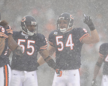 CHICAGO, IL - DECEMBER 12: Brian Urlacher #54 of the Chicago Bears calls a defensive play as teammate Lance Briggs #55 moves into position against the New England Patriots at Soldier Field on December 12, 2010 in Chicago, Illinois. The Patriots defeated t