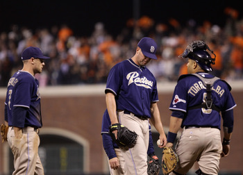 SAN FRANCISCO - OCTOBER 01:  Clayton Richard #33 of the San Diego Padres is surrounded by teammates as he waits for manager Bud Black to take him out of the game after he gave up a home run to Aaron Rowand #33 of the San Francisco Giants in the sixth inni