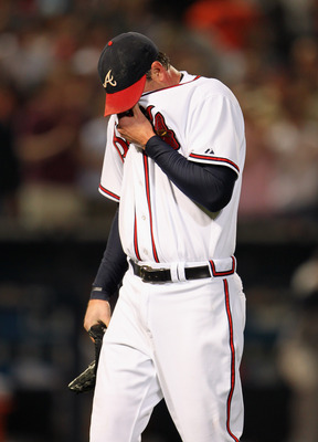 ATLANTA - OCTOBER 11:  Starting pitcher Derek Lowe #32 of the Atlanta Braves reacts after loading the bases as he is about to be pulled from the game during the 7th inning of Game Four of the NLDS of the 2010 MLB Playoffs against the San Francisco Giants