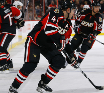 OTTAWA, ON - NOVEMBER 24: Chris Phillips #4 of the Ottawa Senators looks to make a cross ice pass during a game against the Dallas Stars at Scotiabank Place on November 24, 2010 in Ottawa, Ontario, Canada. (Photo by Phillip MacCallum/Getty Images)