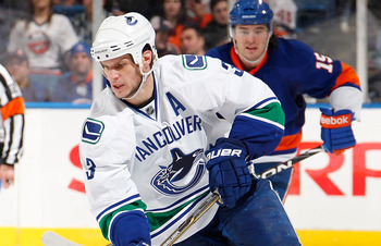 UNIONDALE, NY - JANUARY 11:  Kevin Bieksa #3 of the Vancouver Canucks skates during an NHL game against the New York Islanders at Nassau Coliseum on January 11, 2011 in Uniondale, New York.  (Photo by Paul Bereswill/Getty Images)