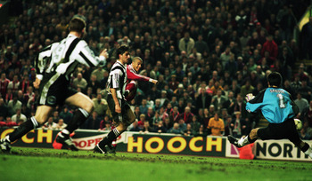 3 Apr 1996:  Stan Collymore of Liverpool scores a dramatic last minute winning goal during the FA Carling Premiership match between Liverpool and Newcastle United played at Anfield, in Liverpool, England. Liverpool won the match 4-3. \ Mandatory Credit: S