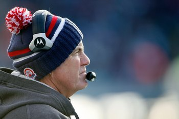 FOXBORO, MA - JANUARY 10:  Head coach Bill Belichick of the New England Patriots looks on against the Baltimore Ravens during the 2010 AFC wild-card playoff game at Gillette Stadium on January 10, 2010 in Foxboro, Massachusetts.  (Photo by Elsa/Getty Imag