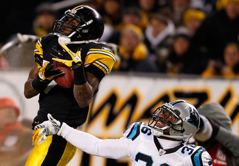 PITTSBURGH - DECEMBER 23:  Mike Wallace #17 of the Pittsburgh Steelers catches a pass in front of Robert McClain #36 of the Carolina Panthers during the game on December 23, 2010 at Heinz Field in Pittsburgh, Pennsylvania.  (Photo by Jared Wickerham/Getty
