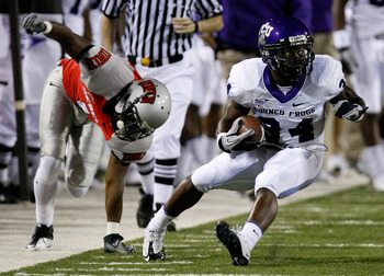 LAS VEGAS - OCTOBER 30:  Ed Wesley #34 of the Texas Christian University Horned Frogs runs for yardage after getting away from Will Chandler #1 of the UNLV Rebels during the first quarter of their game at Sam Boyd Stadium October 30, 2010 in Las Vegas, Ne