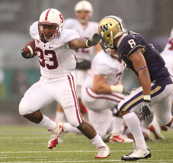 SEATTLE - OCTOBER 30:  Running back Stepfan Taylor #33 of the Stanford Cardinal rushes against Nate Williams #8 of the Washington Huskies on October 30, 2010 at Husky Stadium in Seattle, Washington. Stanford won 41-0. (Photo by Otto Greule Jr/Getty Images