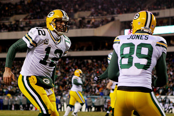 PHILADELPHIA, PA - JANUARY 09:  Aaron Rodgers #12 celebrates with James Jones #89 of the Green Bay Packers after scoring a touchdown in the second quarter against the Philadelphia Eagles during the 2011 NFC wild card playoff game at Lincoln Financial Fiel