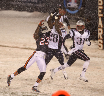 CHICAGO - DECEMBER 12: Darius Butler #28 of the New England Patriots breaks up a pass intended for Devin Hester #23 of the Chicago Bears as teammate Brandon Meriweather #31 backs up the play at Soldier Field on December 12, 2010 in Chicago, Illinois. The