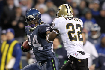 SEATTLE, WA - JANUARY 08:  Running back Marshawn Lynch #24 of the Seattle Seahawks runs for a 67-yard touchdown run in the fourth quarter against Tracy Porter #22 of the New Orleans Saints during the 2011 NFC wild-card playoff game at Qwest Field on Janua
