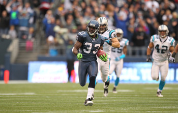 SEATTLE - DECEMBER 05:  Running back Leon Washington #33 of the Seattle Seahawks returns a punt for 84 yards against the Carolina Panthers at Qwest Field on December 5, 2010 in Seattle, Washington. Washington was down at the 2 yard line on the play, and t