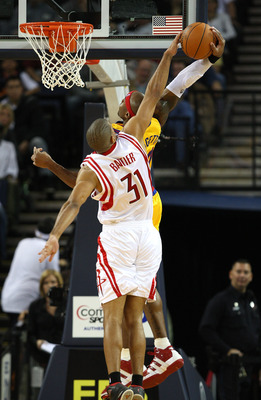 OAKLAND, CA - DECEMBER 03:  Corey Maggette #50 of the Golden State Warriors has his shot blocked by Shane Battier #31 of the Houston Rockets during an NBA game at Oracle Arena on December 3, 2009 in Oakland, California. NOTE TO USER: User expressly acknow