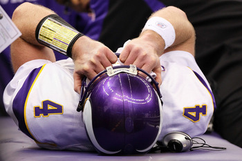 NEW ORLEANS - JANUARY 24:  Brett Favre #4 of  the Minnesota Vikings is checked on by medical staff after getting injured on a play against the New Orleans Saints during the NFC Championship Game at the Louisiana Superdome on January 24, 2010 in New Orlean