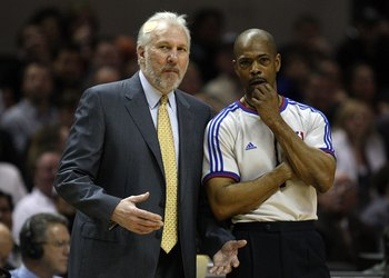 SAN ANTONIO - JANUARY 31:  NBA referee Tom Washington with Gregg Popovich of the San Antonio Spurs on January 31, 2009 at AT&T Center in San Antonio, Texas.  NOTE TO USER: User expressly acknowledges and agrees that, by downloading and/or using this Photo