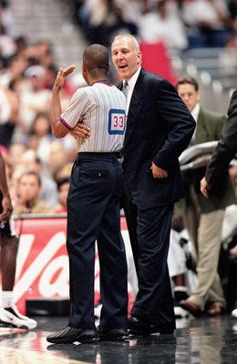31 Oct 2000: Head Coach Gregg Popovich  of the San Antonio Spurs laughs with the referee during the game against the Indiana Pacers at the Alamodome in San Antonio, Texas. The Spurs defeated the Pacers 98-85.    NOTE TO USER: It is expressly understood th