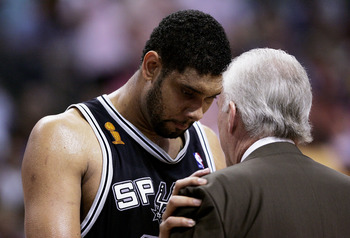 AUBURN HILLS, MI - JUNE 19:  Tim Duncan #21 of the San Antonio Spurs has a one-on-one talk with head coach Gregg Popovich in the first half against the Detroit Pistons in Game five of the 2005 NBA Finals at The Palace of Auburn Hills on June 19, 2005 in A