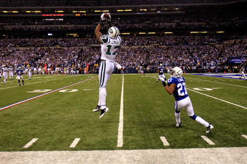 INDIANAPOLIS, IN - JANUARY 08:  Braylon Edwards #17 of the New York Jets makes an 18-yard reception in the final minute of the fourth quarter against Jacob Lacey #27 of the Indianapolis Colts during their 2011 AFC wild card playoff game at Lucas Oil Stadi