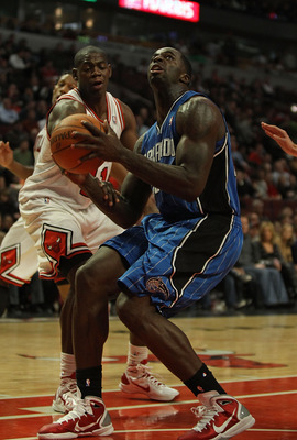 CHICAGO, IL - DECEMBER 01: Brandon Bass #30 of the Orlando Magic looks to shoot under pressure from Ronnie Brewer #11 of the Chicago Bulls at the United Center on December 1, 2010 in Chicago, Illinois. The Magic defeated the Bulls 107-78. NOTE TO USER: Us