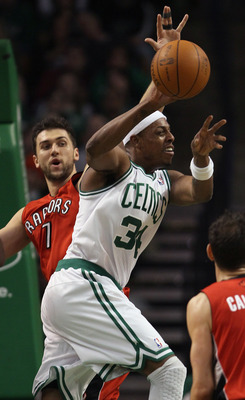 BOSTON, MA - JANUARY 07:  Paul Pierce #34 of the Boston Celtics passes the ball as Andrea Bargnani #7 of the Toronto Raptors defends on January 7, 2011 at the TD Garden in Boston, Massachusetts. The Celtics defeated the Raptors 122-102. NOTE TO USER: User