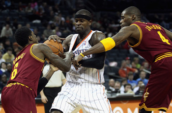 CHARLOTTE, NC - DECEMBER 29:  Teammates Manny Harris #6 and Antawn Jamison #4 of the Cleveland Cavaliers battle for a loose ball with Stephen Jackson #1 of the Charlotte Bobcats during their game at Time Warner Cable Arena on December 29, 2010 in Charlott