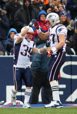 ORCHARD PARK, NY - DECEMBER 26:  Danny Woodhead #39 and Rob Gronkowski #87 of the New England Patriots celebrate Woodehead's 29 yard touchdown run in the first quarter against the Buffalo Bills at Ralph Wilson Stadium on December 26, 2010 in Orchard Park,