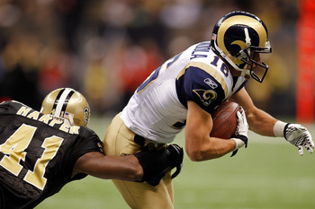 NEW ORLEANS, LA - DECEMBER 12:  Danny Amendola #16 of the St. Louis Rams is tackled by Roman Harper #41 of the New Orleans Saints at the Louisiana Superdome on December 12, 2010 in New Orleans, Louisiana. The Saints defeated the Rams 31-13.  (Photo by Chr