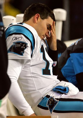 SEATTLE - JANUARY 22:  Quarterback Jake Delhomme #17 of the Carolina Panthers reacts reacts on the bench in the fourth quarter of the NFC Championship Game against the Seattle Seahawks at Qwest Stadium on January 22, 2006 in Seattle, Washington. Seattle w