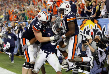 GLENDALE, AZ - JANUARY 10:  (C) Michael Dyer #5 of the Auburn Tigers celebrates with teammates after he runs the ball for 16-yards and is called down at the one-yardline with 10 seconds remaining in the fourth quarter against the Oregon Ducks during the T