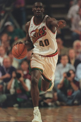 14 Jun 1996:  Forward Shawn Kemp of the Seattle Supersonics looks up court as he signals to his teammate while dribbling the basketball on a fast break during the Sonics 89-78 victory over the Chicago Bulls in the NBA Championship Finals at the Key Arena