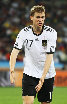 DURBAN, SOUTH AFRICA - JULY 07:  Per Mertesacker of Germany gestures during the 2010 FIFA World Cup South Africa Semi Final match between Germany and Spain at Durban Stadium on July 7, 2010 in Durban, South Africa.  (Photo by Joern Pollex/Getty Images)