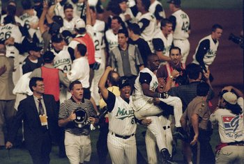 26 Oct 1997:   Shortstop Edgar Renteria of the Florida Marlins is carried by teammates outfielder Gary Sheffield and pitcher Livan Hernandez  after 11 innings of the 7th game of the 1997 World Series against the Cleveland Indians at Pro Player Stadium in