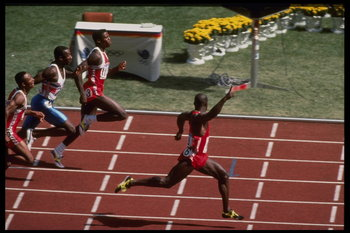 24 Sep 1988:  Ben Johnson of Canada celebrates as he crosses the finish line well ahead of Carl Lewis of the USA and Linford Christie of Great Britain to win the mens 100m final during the 1988 Summer Olympic Games in Seoul, South Korea.  Johnson won theg