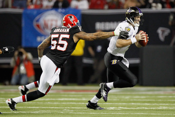 ATLANTA - NOVEMBER 11:  John Abraham #55 of the Atlanta Falcons pressures quarterback Joe Flacco #5 of the Baltimore Ravens at Georgia Dome on November 11, 2010 in Atlanta, Georgia.  (Photo by Kevin C. Cox/Getty Images)