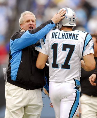 CHARLOTTE, NC - OCTOBER 8:  Coach John Fox (L) congratulates quarterback Jake Delhomme #17 of the Carolina Panthers after a touchdown against the Cleveland Browns during the second quarter on October 8, 2006 at Bank of America Stadium in Charlotte, North