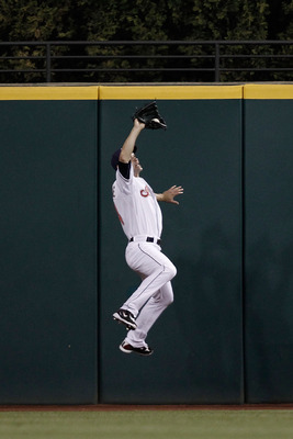CLEVELAND - APRIL 30:   Grady Sizemore #24 of the Cleveland Indians makes a catch in the outfield against the Minnesota Twins during the game on April 30, 2010 at Progressive Field in Cleveland, Ohio.  (Photo by Jared Wickerham/Getty Images)
