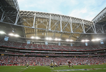 GLENDALE, AZ - DECEMBER 05:  General view of action as quarterback Derek Anderson #3 of the Arizona Cardinals prepares to snap the ball during the NFL game against the St. Louis Rams at the University of Phoenix Stadium on December 5, 2010 in Glendale, Ar