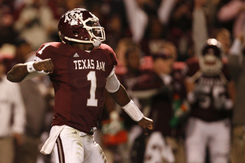 COLLEGE STATION, TX - NOVEMBER 26: Quarterback Jerrod Johnson #1 of the Texas A&M Aggies celebrates after throwing a touchdown pass against the Texas Longhorns in the first half at Kyle Field on November 26, 2009 in College Station, Texas. (Photo by Aaron