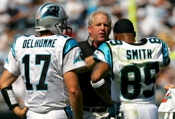 CHARLOTTE, NC - OCTOBER 1:  Head coach John Fox talks to Jake Delhomme #17 and teammate Steve Smith #89 of the Carolina Panthers during their game against the New Orleans Saints on October 1, 2006 at Bank of America Stadium in Charlotte, North Carolina. T