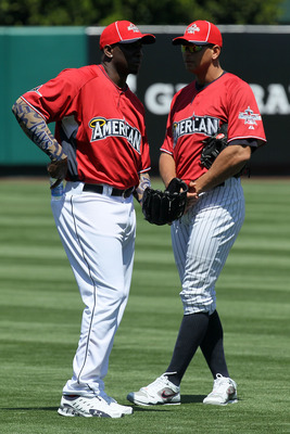 ANAHEIM, CA - JULY 12:  American League All-Star Rafael Soriano #29 of the Tampa Bay Rays talks with American League All-Star Alex Rodriguez #13 of the New York Yankees during Gatorade All-Star Workout Day at Angel Stadium of Anaheim on July 12, 2010 in A