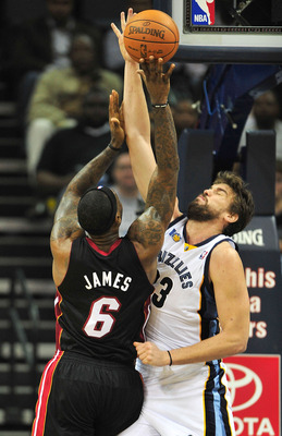MEMPHIS, TN - NOVEMBER 20:  LeBron James #6 of the Miami Heat shoots under pressure from Marc Gasol #33 of the Memphis Grizzlies at FedExForum on November 20, 2010 in Memphis, Tennessee. The Grizzlies won 97-95.  NOTE TO USER: User expressly acknowledges