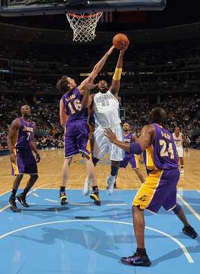 DENVER - NOVEMBER 11:  Nene #16 of the Denver Nuggets takes a shot against Pau Gasol #16 of the Los Angeles Lakers at the Pepsi Center on November 11, 2010 in Denver, Colorado. The Nuggets defeated the Lakers 118-112.  NOTE TO USER: User expressly acknowl