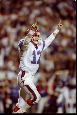 27 Jan 1991: Quarterback Jim Kelly of the Buffalo Bills celebrates during Super Bowl XXV against the New York Giants at Tampa Stadium in Tampa, Florida. The Giants won the game, 20-19.