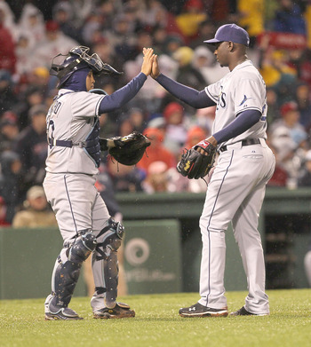 BOSTON - APRIL 17:  Dioner Navarro #30 and Rafael Soriano #29 of the Tampa Bay Rays celebrate after defeating the Red Sox, 3-1, in extra innings at Fenway Park on April 17, 2010 in Boston, Massachusetts.  The contest  is a completion of the game that was