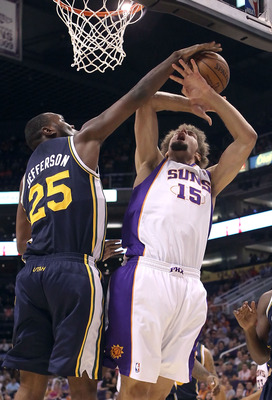 PHOENIX - OCTOBER 12:  Al Jefferson #25 of the Utah Jazz blocks a shot from Robin Lopez #15 of the Phoenix Suns during the preseason NBA game at US Airways Center on October 12, 2010 in Phoenix, Arizona. NOTE TO USER: User expressly acknowledges and agree