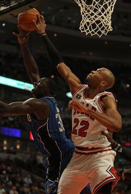 CHICAGO, IL - DECEMBER 01: Taj Gibson #22 of the Chicago Bulls attempts to block a shot by Brandon Bass #30 of the Orlando Magic at the United Center on December 1, 2010 in Chicago, Illinois. The Magic defeated the Bulls 107-78. NOTE TO USER: User express