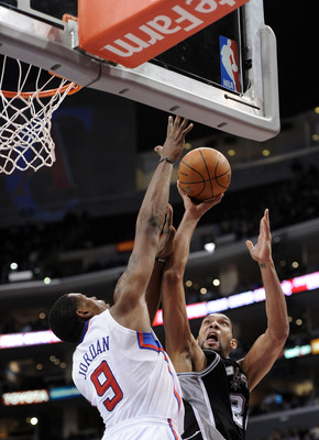 LOS ANGELES, CA - DECEMBER 01:  Tim Duncan #21 of the San Antonio Spurs has his shot blocked by DeAndre Jordan #9 of the Los Angeles Clippers at the Staples Center on December 1, 2010 in Los Angeles, California.  NOTE TO USER: User expressly acknowledges
