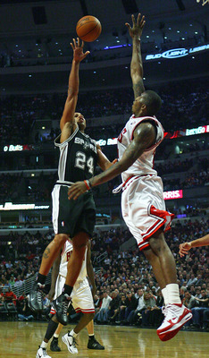 CHICAGO - OCTOBER 29:  Richard Jefferson #24 of the San Antonio Spurs puts up a shot over Tyrus Thomas #24 of the Chicago Bulls at the United Center on October 29, 2009 in Chicago, Illinois. NOTE TO USER: User expressly acknowledges and agrees that, by do