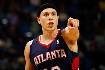 NEW ORLEANS, LA - DECEMBER 26:  Mike Bibby #10 of the Atlanta Hawks calls a play during the game against the New Orleans Hornets at the New Orleans Arena on December 26, 2010 in New Orleans, Louisiana.  The Hornets defeated the Hawks 93-86.  NOTE TO USER: